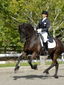 Jane Savoie and her 20-year-old semi-retired Grand Prix Friesian gelding, Moshi.
